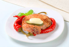 Pan-fried pork chop with chili peppers Stock Photos
