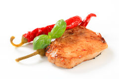 Pan-fried pork chop with chili peppers Stock Photo