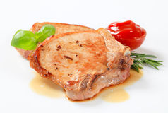Pan-fried pork chops stock images