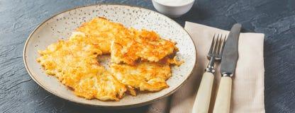 Pan-fried potato pancakes - rosti, kartoffelpuffer, latkes, draniki, hash browns stock photography