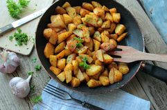 Pan with fried potatoes Royalty Free Stock Photos