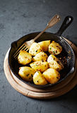 Pan fried potatoes with herbs and spices Stock Photos