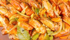 Pan fried Prawns Mediterranean Style. Pan fried Prawns served with Barbeques Sauce ,Mediterranean Style Royalty Free Stock Images