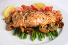 Pan fried salmon, asparagus and mushrooms Royalty Free Stock Images