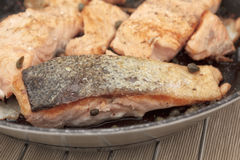 Pan fried salmon fillets. Close up of pan fried salmon fillets with capers Stock Photo