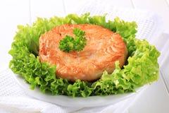 Pan fried salmon patty Royalty Free Stock Image