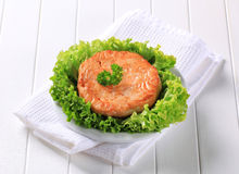 Pan fried salmon patty Stock Photography