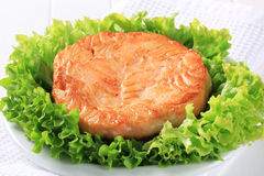 Pan fried salmon patty Stock Images