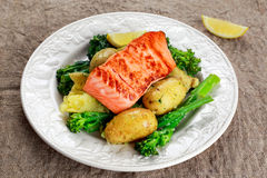 Pan fried Salmon Served with potatoes and tenderstem broccoli. Stock Photo