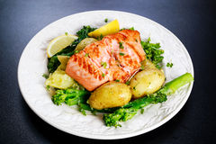 Pan fried Salmon Served with potatoes and tenderstem broccoli. Stock Photography