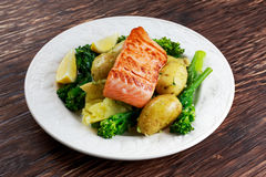 Pan fried Salmon Served with potatoes and tenderstem broccoli. Stock Images