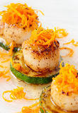 Pan fried scallops with citrus zest Stock Photography