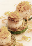 Pan fried scallops with citrus zest Royalty Free Stock Images