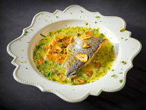 Pan-fried sea trout in green sauce Stock Image