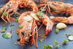 Pan fried shrimp. Frying un-peeled black tiger prawns closeup Stock Photography
