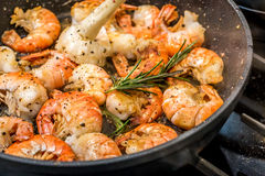 Pan fried shrimp with rosemary. In a pan Stock Photo