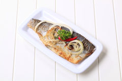 Pan fried trout stock photos