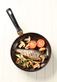 Pan fried trout stock images