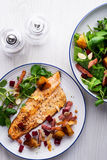 Pan-fried trout with bacon and beetroot royalty free stock photography