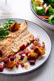 Pan-fried trout with bacon and beetroot stock image