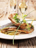 Pan fried trout and baked potato Stock Photo