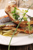 Pan fried trout and baked potato Royalty Free Stock Photography