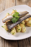 Pan fried trout fillets with potatoes Stock Photos