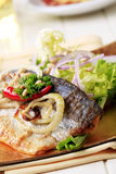 Pan fried trout with green salad Stock Photos