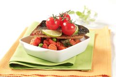 Pan fried trout  and mixed vegetables Royalty Free Stock Image