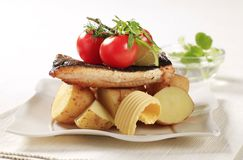 Pan fried trout and potatoes Royalty Free Stock Images