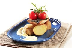 Pan fried trout and potatoes Stock Photo