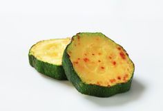 Pan fried zucchini Stock Photos