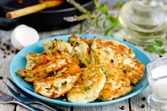 Pan fried zucchini pancakes royalty free stock images