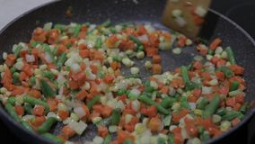 Pan fry meal of delicious asparagus, pepper, corn and carrot. vegetarian meal. Close up of a pan fry meal of delicious asparagus, pepper, corn and carrot for a stock video footage