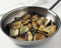 Pan-frying the eggplants Royalty Free Stock Photos