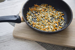 Pan with frying leek Royalty Free Stock Images