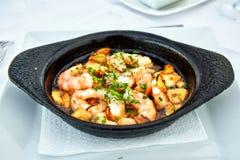 Pan of Garlic Prawns. On restaurant table Stock Image