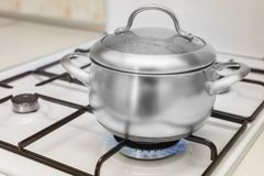 Pan on a gas stove Royalty Free Stock Images