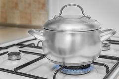 Pan on a gas stove Stock Images