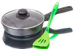 Pan with glass lid and spatula Stock Photography