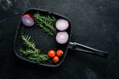 Pan grilling of vegetables. On a black stone background. Top view. Free copy space stock images