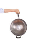Pan in hand on white background Royalty Free Stock Images