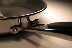 Pan Handle. A close up of the handle of a stainless steel frying pan Royalty Free Stock Photos