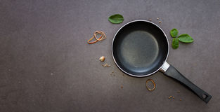 Pan with handle on black background. Royalty Free Stock Photos