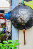 Pan hanging on the wall, selective focus point. Royalty Free Stock Image