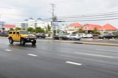 Pan image of yellow hummer Royalty Free Stock Photos