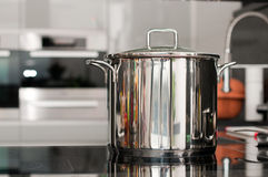 Pan in the kitchen. Steel pan on a hot plate in the kitchen Stock Photo