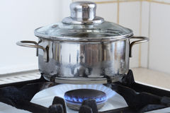 Pan On Kitchen Stove Royalty Free Stock Image