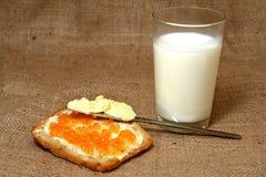 Pan, mantequilla, caviar, leche Foto de archivo libre de regalías