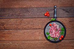The pan with the meat on the Board. Royalty Free Stock Images